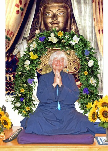 Photo of the Wisdom Master, praying hands with flower garland